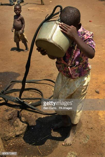 A child drinks wellwater from a bucket in the faminestricken village of Kanyopola in central Malawi The United Nations currently estimates 184...