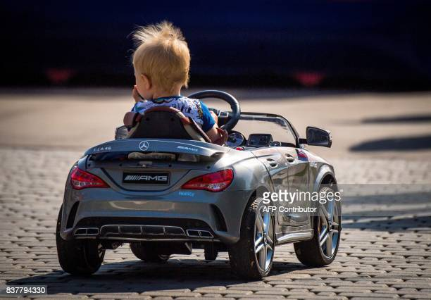 A child drives an electrical Mercedes AMG toy car in a park of the city of Samara on August 23 2017 Samara will host several games of the 2018 FIFA...