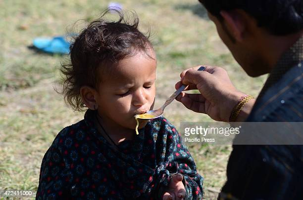 A child eat at temporary shelter in the relief camp A major 78 earthquake hit Kathmandu midday on Saturday and was followed by multiple aftershocks...