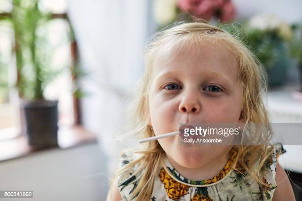 child eating a lollipop - lollipop stock pictures, royalty-free photos & images