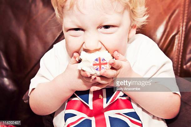 child eating a union jack cupcake - british flag cake stock pictures, royalty-free photos & images