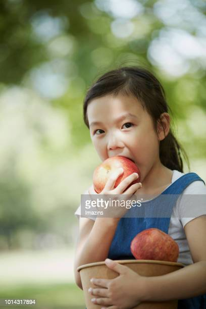 a child eating an apple - kid girl eating apple stock photos and pictures