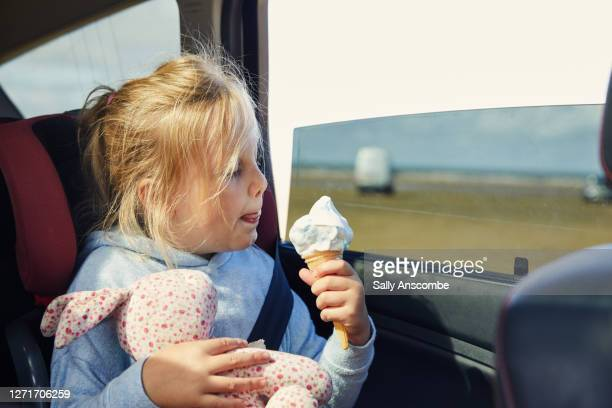 child eating an ice cream in a car - childhood stock pictures, royalty-free photos & images