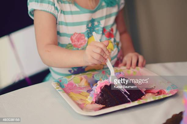 child eating cake - mid section stock photos and pictures