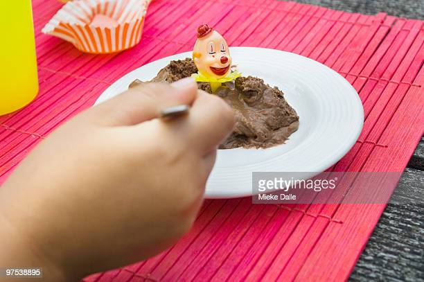 Child eating chocolate mousse