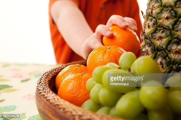 Child Eating Healthy Fruit Basket