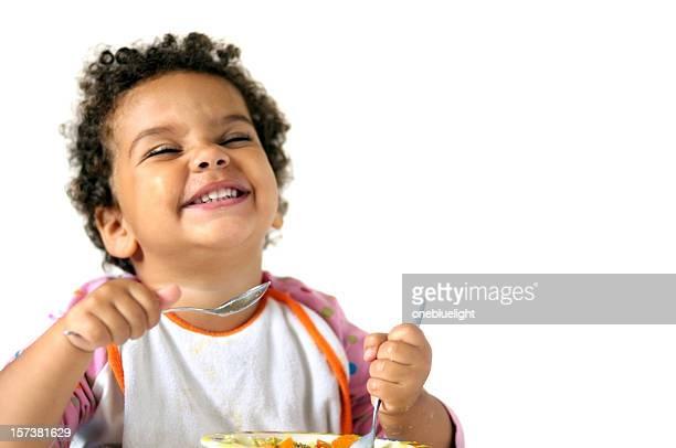 Child eating isolated against white background