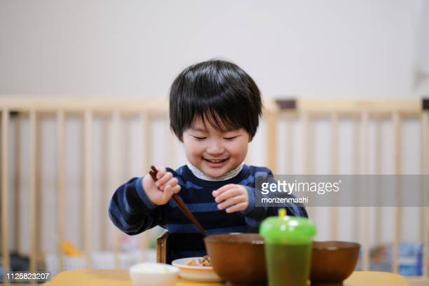 child eating meal at home - childhood stock pictures, royalty-free photos & images