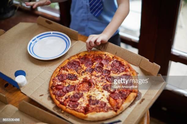 child eating pizza - take away food stock pictures, royalty-free photos & images