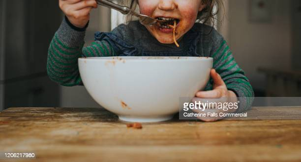 child eating spaghetti - food stock pictures, royalty-free photos & images