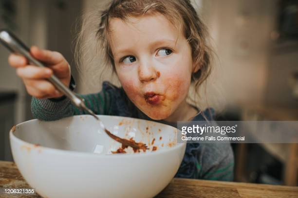 child eating spaghetti - human face stock pictures, royalty-free photos & images