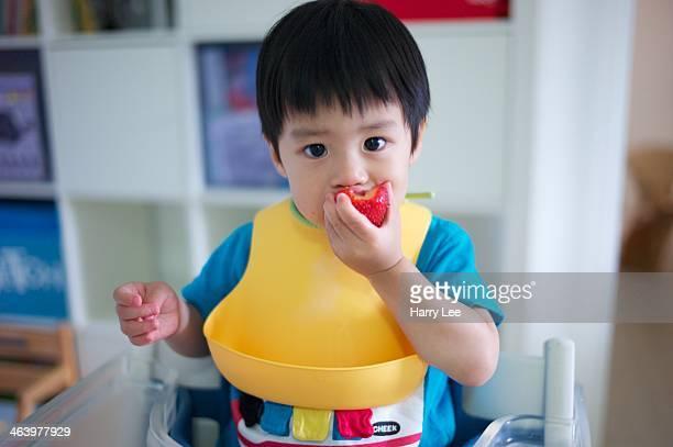 Child eating strawberry