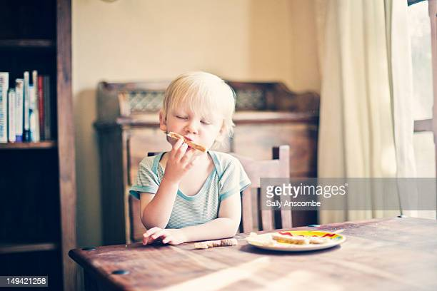 Child eating toast for breakfast