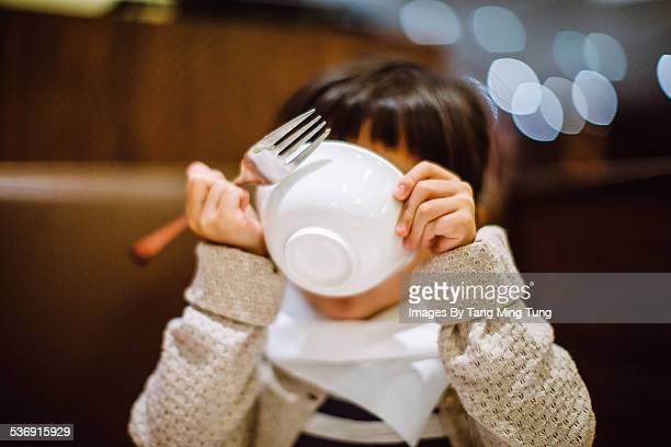 Child enjoy having meal in restaurant