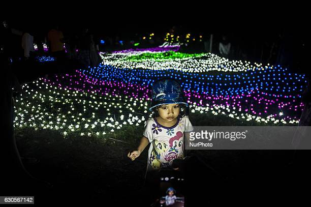 A child enjoyed the Festival of Lights in Kaliurang Yogyakarta Indonesia on December 26 2016 This events to attract tourists both domestic and...