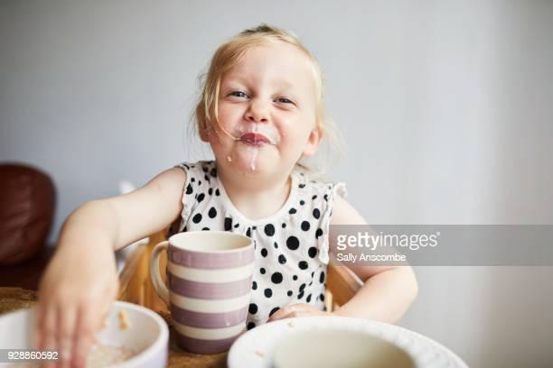 Child enjoying eating breakfast