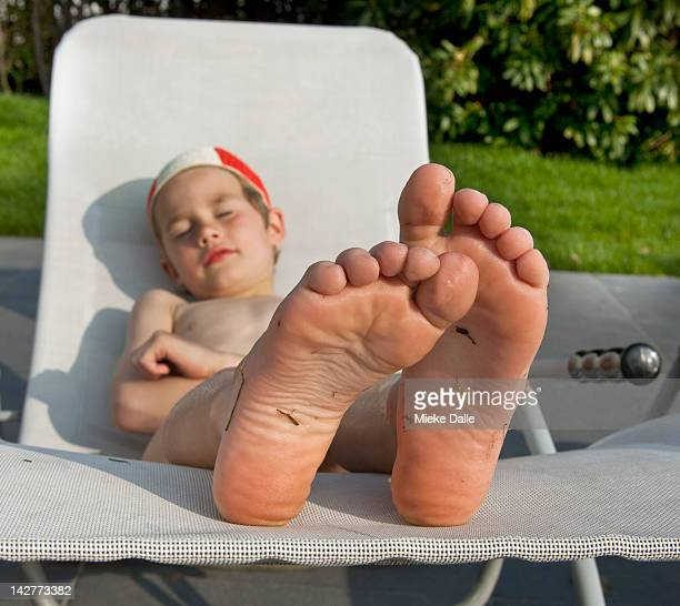 Child enjoying the sun on a lounger