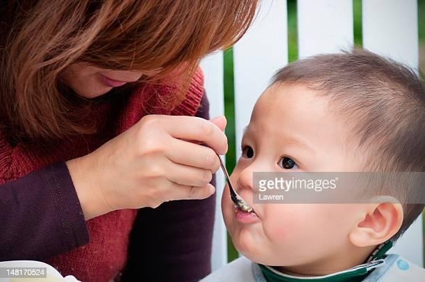 Child enjoys sweet cake