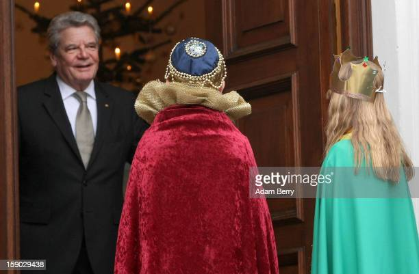 Child Epiphany carolers, known as Sternsinger in German, visit German President Joachim Gauck at Bellevue presidential palace on January 6, 2013 in...