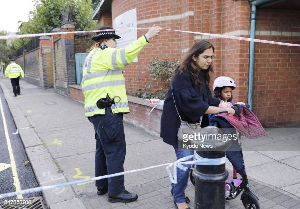 A child evacuates from a school in London on Sept 15 after an explosion occurred in a subway car near Parsons Green station ==Kyodo