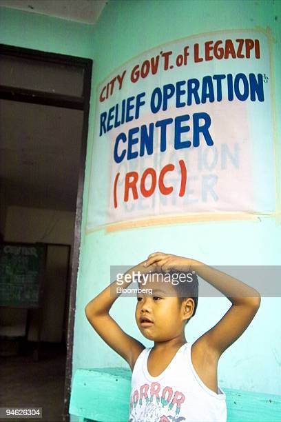 A child evacuee waits for the arrival of food supplies in Legazpi City Albay the Philippines on Tuesday August 15 2006