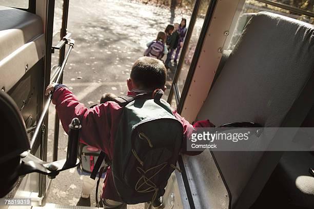child exiting school bus - ein junge allein stock-fotos und bilder