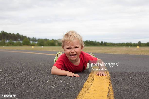 child falling on the tarmac