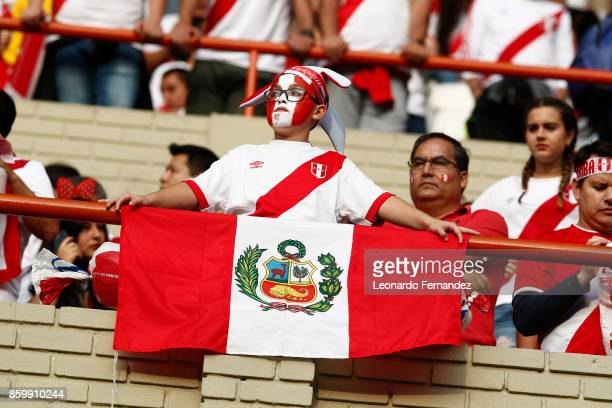 A child fan of Peru enjoys the atmosphere prior to the match between Peru and Colombia as part of FIFA 2018 World Cup Qualifiers at National Stadium...