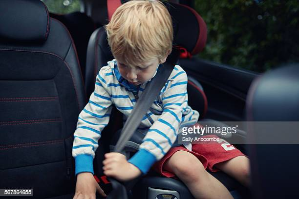 Child fastening his seatbelt