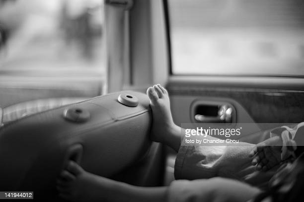 Child feet inside car