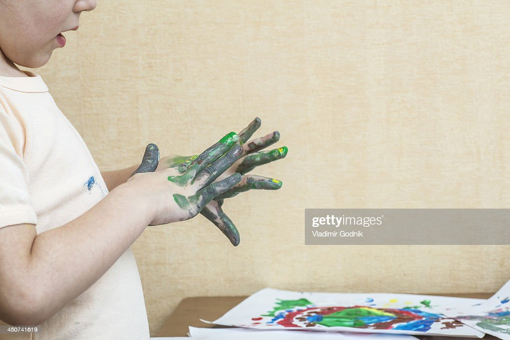 Child finger painting : Stock Photo