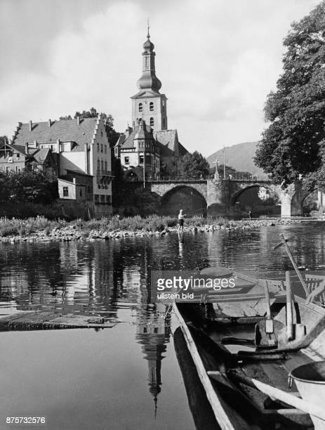 A child fishing at the waterside of the Nahe river in the background the Old Town houses Wolff Tritschler Vintage property of ullstein bild