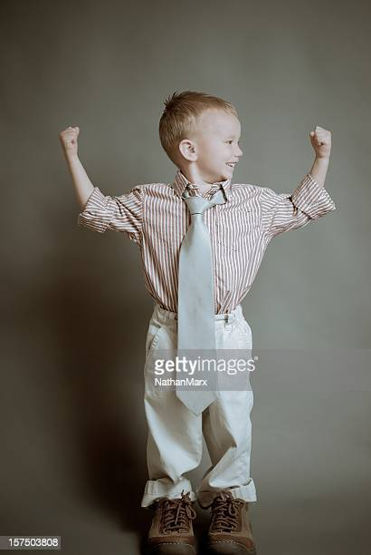 Child flexing muscle
