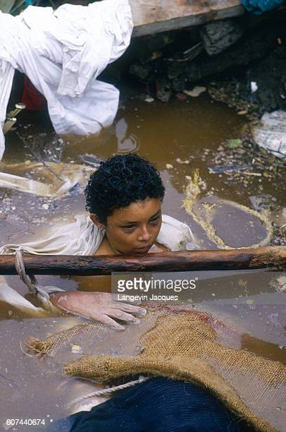 A child floats in muddy water after being caught in a lahar as it flowed from the erupting Nevado del Ruiz volcano in Colombia The 1985 eruption...