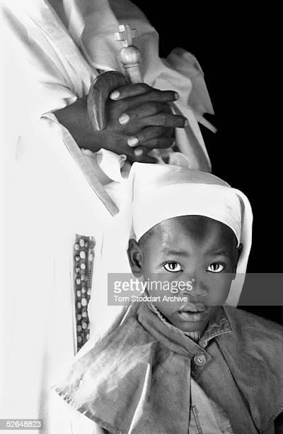 A child follower of the Legion Maria sect photographed during mass in the Fort Jesus area of Kibera slum Nairobi Kenya One million people live in...