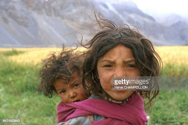Child form the village of Pidmo In the first few months of their lives children learn how to become independent though a family member is almost...