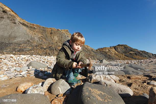 Child Fossil Hunting on Charmouth Beach.