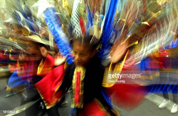 A child from a ''Mas'' band dances in the street August 26 2001 on the first day of the annual Notting Hill Carnival in London The Carnival is the...