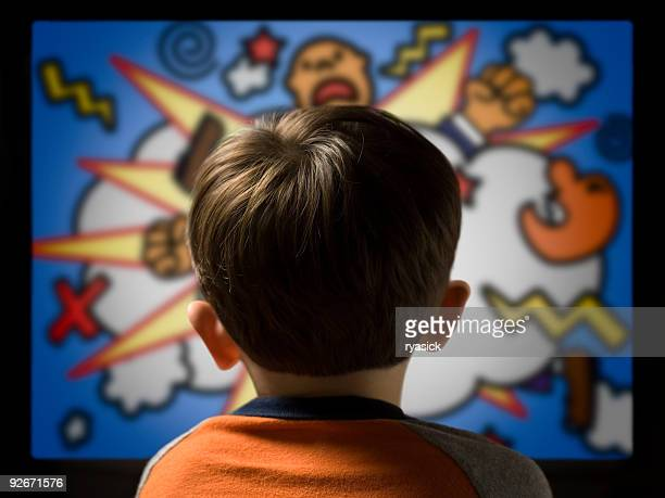 child from behind watching violent cartoon on television - animation stock pictures, royalty-free photos & images