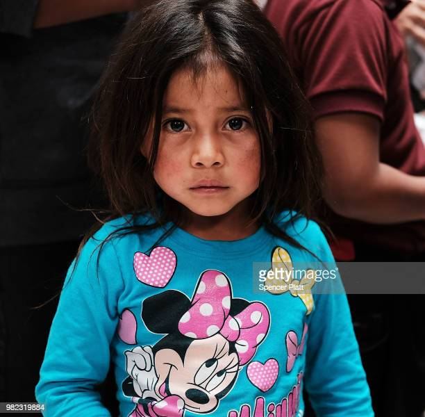 A child from Guatamala arrives with dozens of women men and their children many fleeing poverty and violence in Honduras Guatamala and El Salvador at...