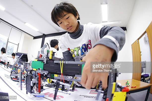 A child from Japan operates his robot at the LEGO Education FIRST Robot Games Tournament on July 5 2013 in Sydney Australia Over 50 teams 550...