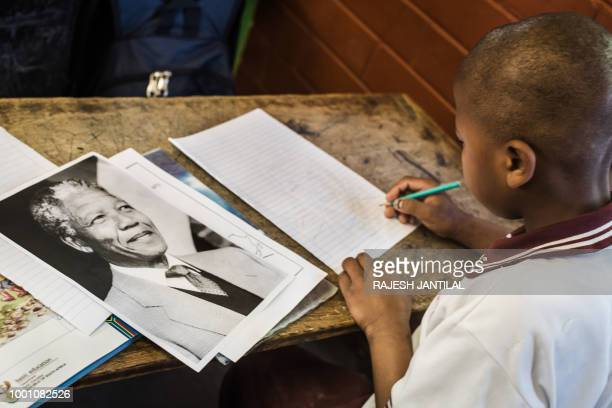 A child from Northlen Primary school draws to commemorate the life of former South African President Nelson Mandela in Durban on July 18 2018 July 18...