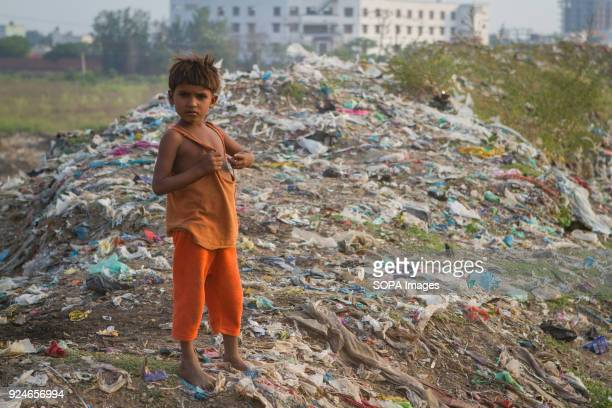 A child from the slum seen standing on a large pile of rubbish Over 25 million people live in Delhi India What is particularly problematic in India...