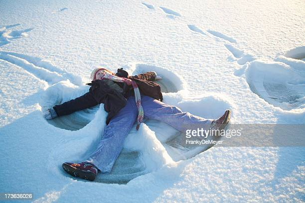 Child fun in snow at sunset
