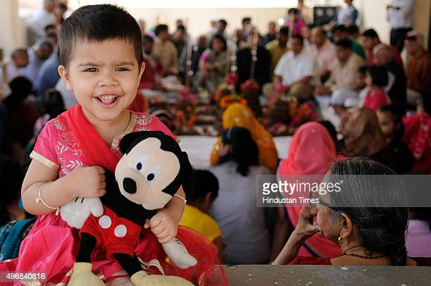 A child gestures as people perform Govardhan Puja also called Annakut at Gaushala on November 12 2015 in Noida India Govardhan Puja is celebrated...