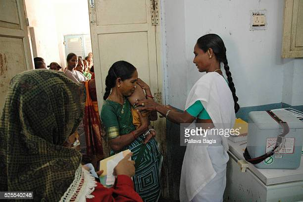 Child gets a BCG shot against tuberculosis.