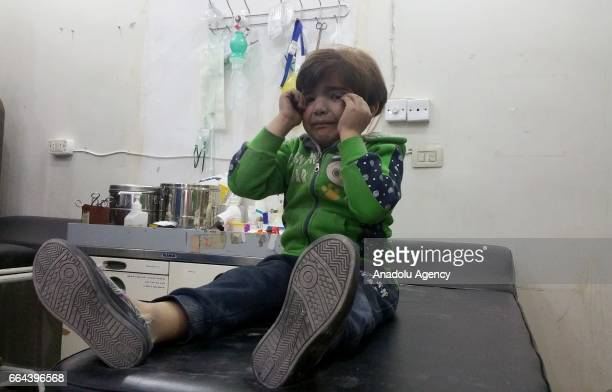 A child gets treatment at a hospital after Assad Regime forces attacked with suspected chlorine gas to Khan Shaykhun town of Idlib Syria on April 4...