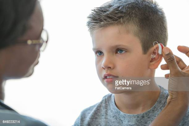 Child Getting a Hearing Aid