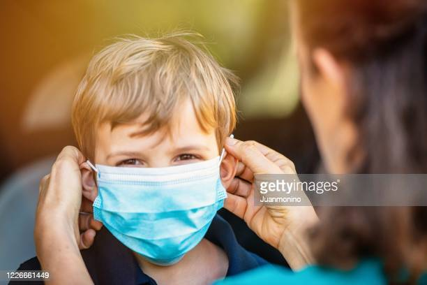 child getting ready to go to school in pandemic times - preschool student stock pictures, royalty-free photos & images