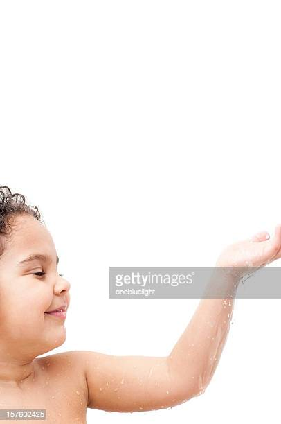 Child getting showered against white background